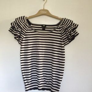 Super cute striped tee with ruffles on sleeves.